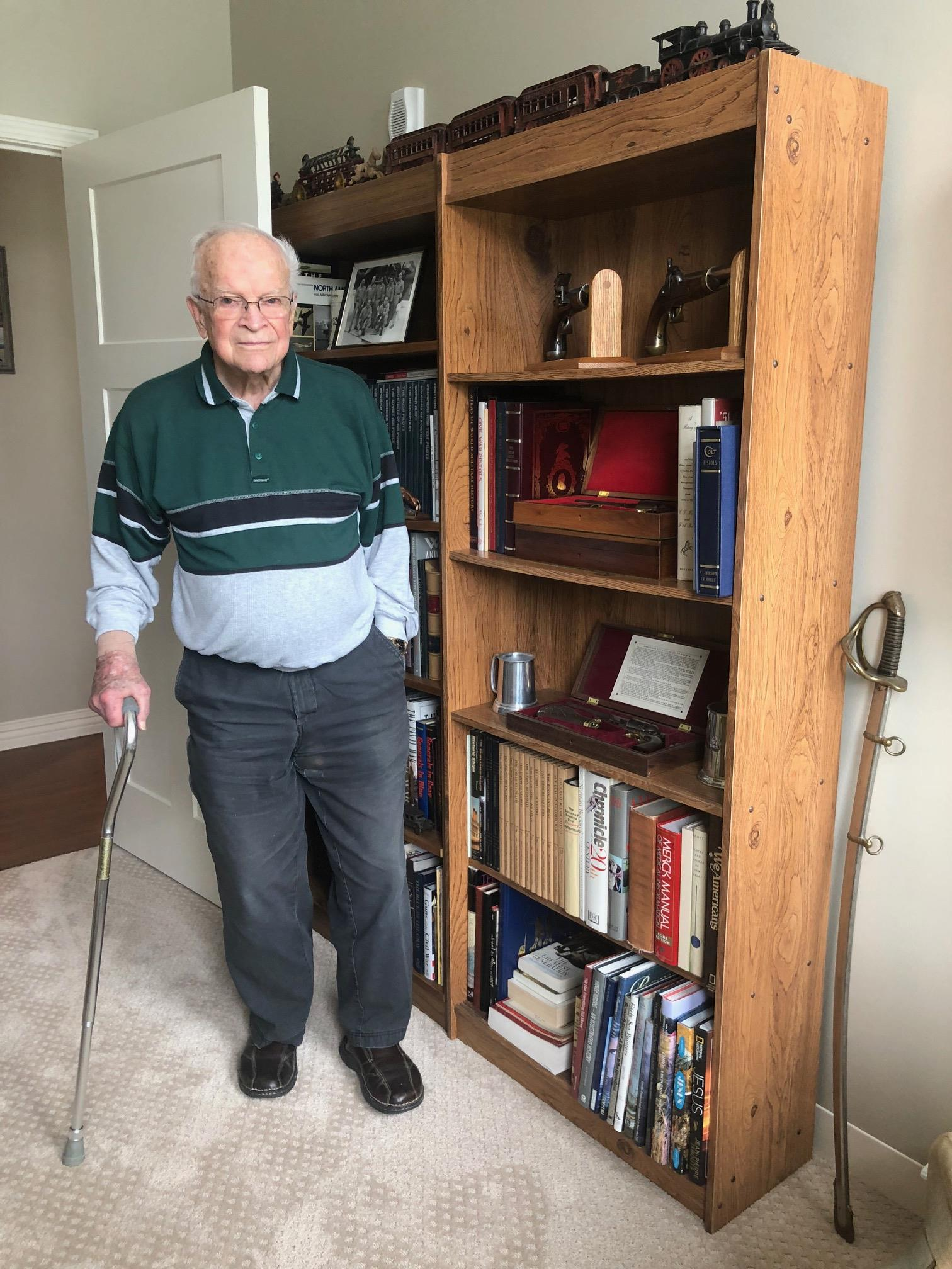Older Man With WWII Collection